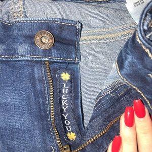 lucky brand jeans w/ slight rips